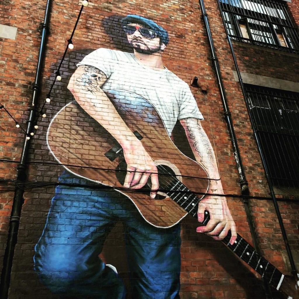 Street murals with guitarist