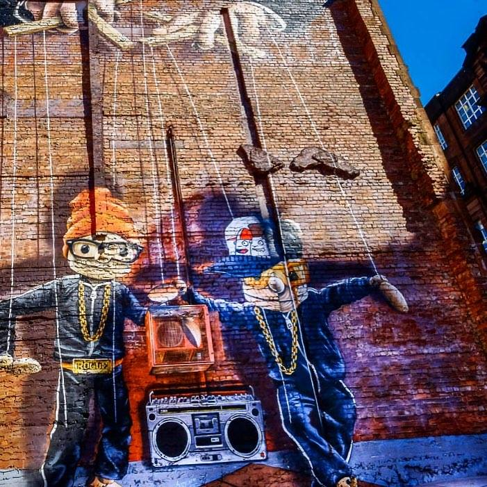 Street murals with puppets