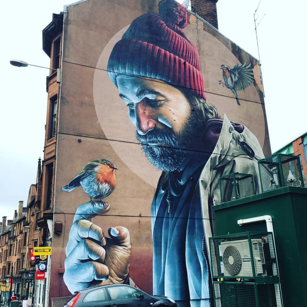 Street murals with St Mungo and Robin red breast