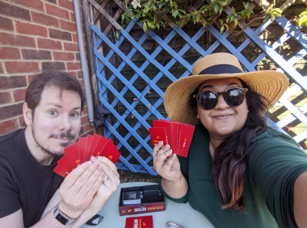 Playing exploding kittens, a card game.